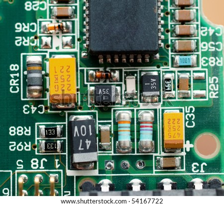 Closeup of chipset on green micro circuit board of computer