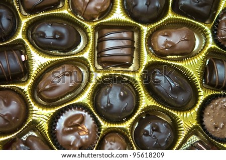 Closeup of chocolate candies in a box.