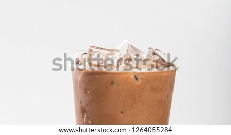 Closeup of chocolate milk tea with ice cubes