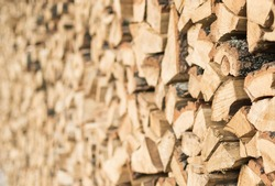 Closeup of chopped firewood in a stack ready for burning