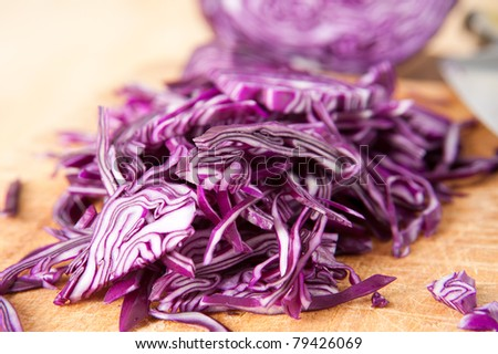 Closeup of Chopped Red Cabbage on Wooden Cutting Board