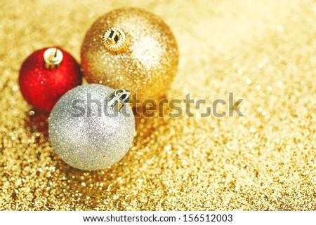 Closeup of Christmas balls on shiny golden background