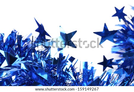 Closeup of christmas blue tinsel with stars. Isolated on a white.