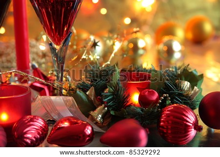 Closeup of christmas decoration and glass of wine. - stock photo