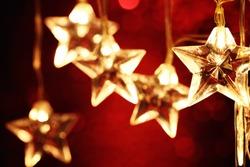 Closeup of Christmas star lights.