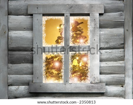 Closeup of christmas tree with lights seen through a wooden cabin window