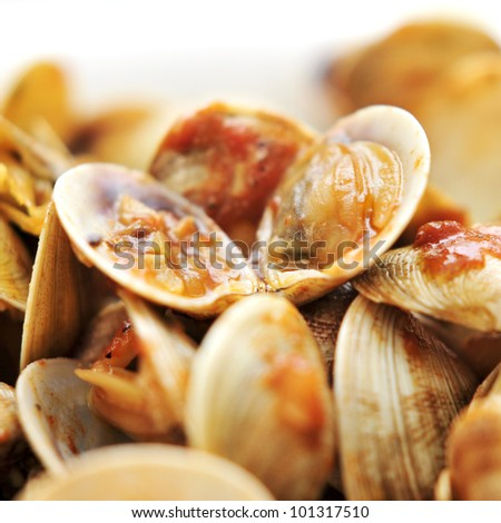 closeup of clams in marinara sauce