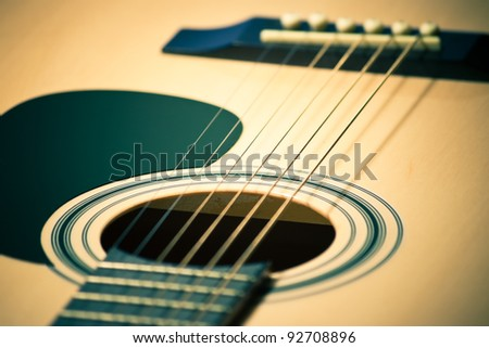 closeup of classic guitar with shallow depth of field