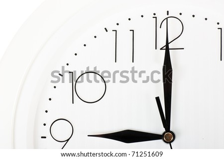 Closeup of clock face. Nine o'clock.