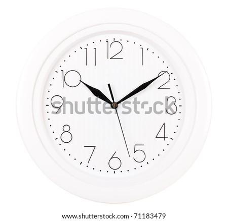 Closeup of clock face. Ten past ten.