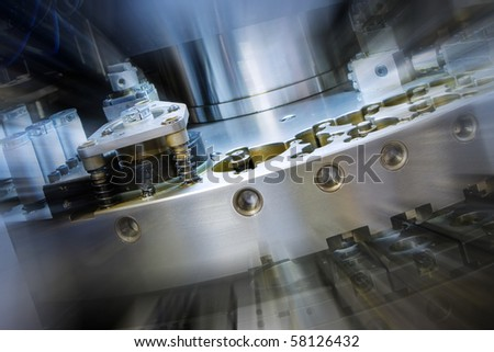 closeup of cnc punching machine with zoom effect
