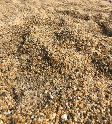 Closeup of coarse sand and gravel on beach