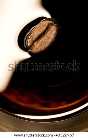 Closeup of coffee bean in a smooth and shiny alcoholic drink