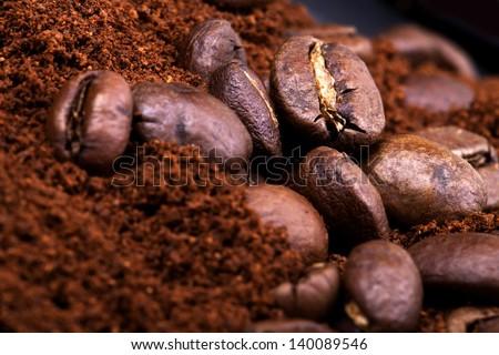 Closeup of coffee beans. Coffee bean on macro ground coffee background. Arabic coffee - ingredient of hot beverage.