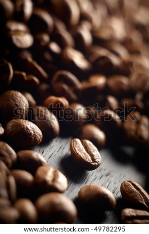 Closeup of coffee beans with focus on one,shallow dof