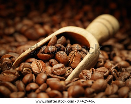 Closeup of coffee beans with wooden scoop