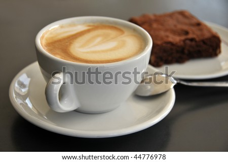Closeup of coffee cup and brownies on a table