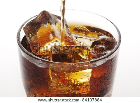 closeup of cola being poured