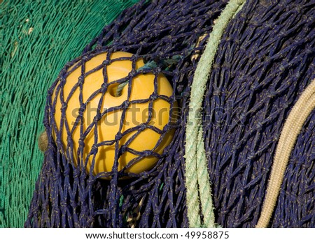 Closeup of color-full finshing net on a trawler.