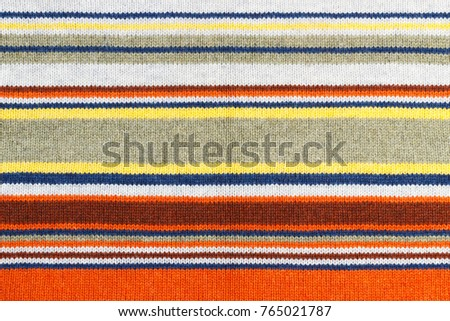 Closeup of colored knitted wool texture. Fabric multicolor background. #765021787