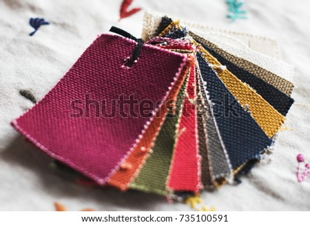 Closeup of colorful fabric samples #735100591