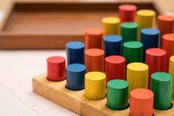 Closeup of colorful wooden Montessori sensorial material learning, Sizing and order block. Kindergarten educational toys, Thinking process, Cognitive skills, Learn Through Play tools concept.