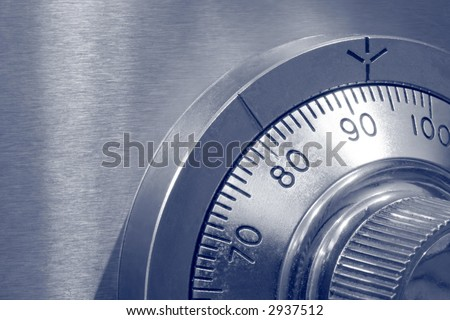 Closeup of combination safe lock ~ blue duotone.