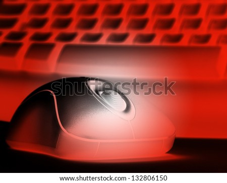 Closeup of computer keyboard and mouse colored red.