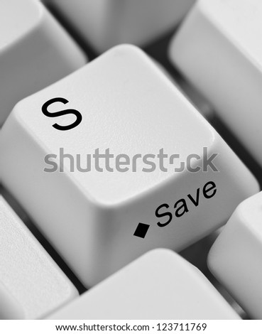 Closeup of computer keyboard keys emphasizing the key S and the word save.