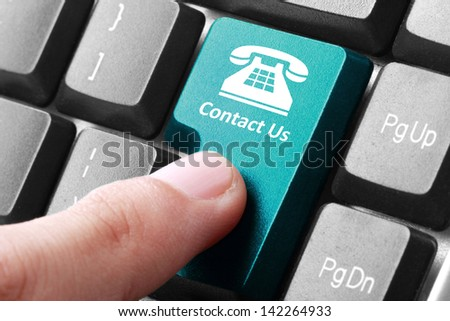 Closeup of contact us button on the keyboard