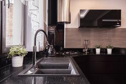 Closeup of countertop and granite sink in brocade kitchen