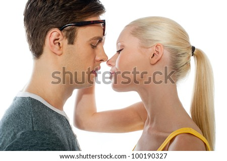 Closeup of couple kissing each other on white background