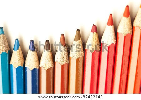 closeup of crayons stack on white background