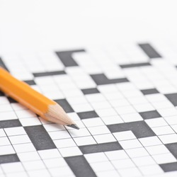 Closeup of crossword puzzle and pencil. Conceptual image of problem solving, finding solutions and intelligence.