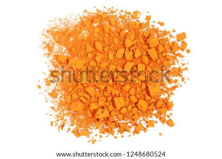 closeup of crushed orange watercolor paint isolated #1248680524
