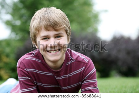closeup of cute young teen boy smiling