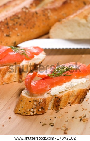 Closeup of delicious canape with smoked salmon cream for Canape spread