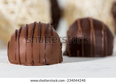 Closeup of delicious chocolates with milk