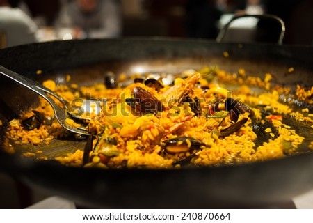 Closeup of delicious paella served in restaurant