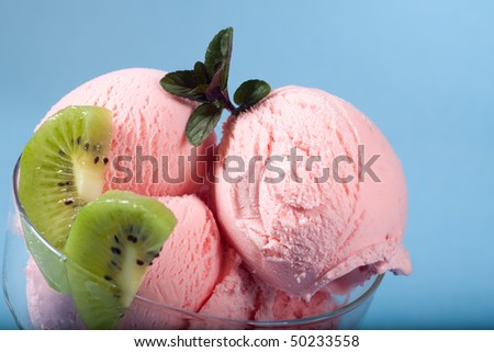 Closeup of delicious Strawberry Ice Cream with fresh kiwi and mint.