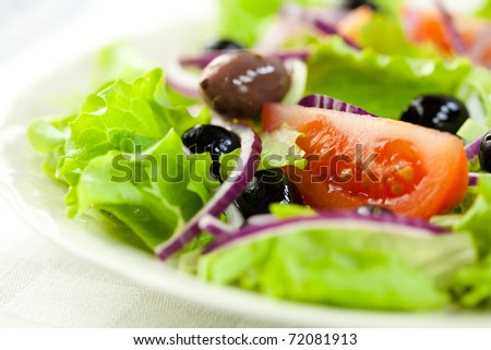 Closeup of delicious vegetable salad with olives