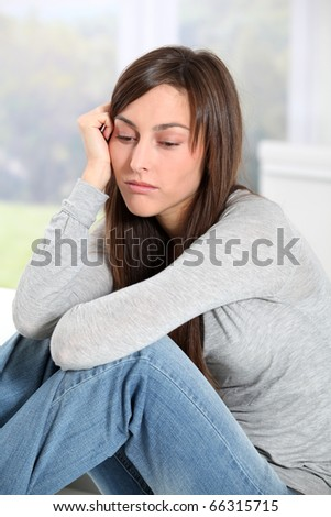 Closeup of depressed young woman