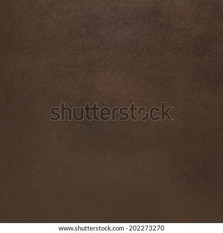 Closeup of detailed brown leather texture background.