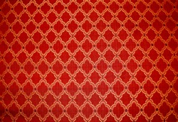 Closeup of Detailed Red, Gold and Black Ornate Upholstery Fabric on Antique Chaise Longue