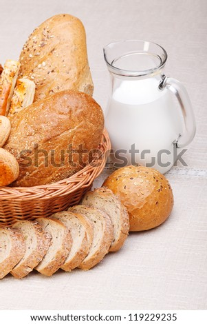 Closeup of different baked products with milk in jug
