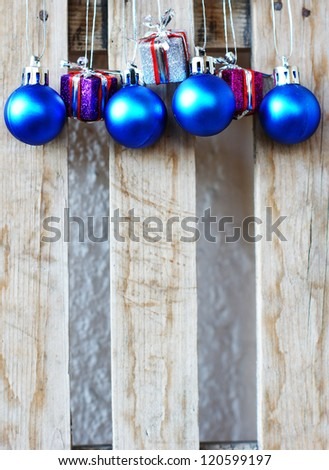 Closeup of different Christmas decoration on the wooden desk