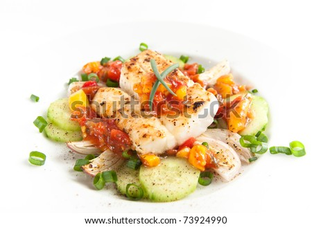 Closeup of Dinner Plate with Grilled White Fish and Vegetables