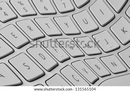 Closeup of distorted computer keyboard with twisted keys