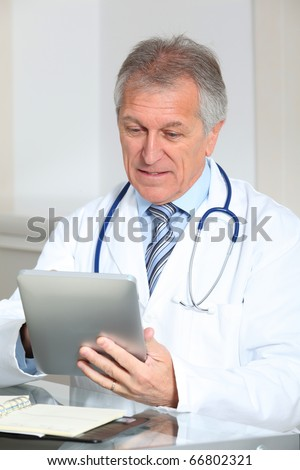 Closeup of doctor in the office with electronic pad