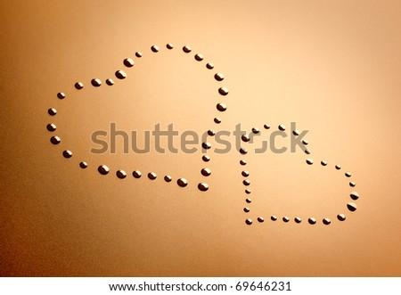 Closeup of drops like heart.